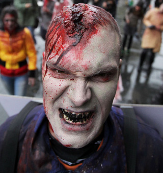 "An actor dressed as a zombie walks on a street in downtown Belgrade October 26, 2010, as part of a promotional campaign for an upcoming U.S. TV series called ""The Walking Dead"". The event is taking place over 24 hours in 26 cities around the world ahead of the show's U.S. premiere on Sunday. REUTERS/Marko Djurica (SERBIA - Tags: ENTERTAINMENT SOCIETY IMAGES OF THE DAY) TELETIPOS_CORREO:%%%,%%%,%%%,ACTOR"